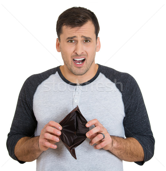 Stock photo: unhappy man with an empty wallet