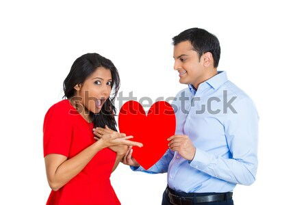 Sad confused man, holding broken heart in his hands Stock photo © ichiosea