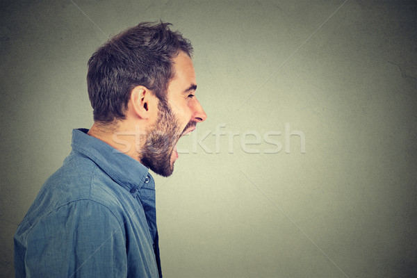 Side profile portrait of young angry man screaming  Stock photo © ichiosea