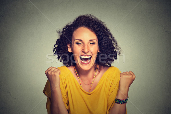 happy woman exults pumping fists ecstatic celebrates success on gray background  Stock photo © ichiosea