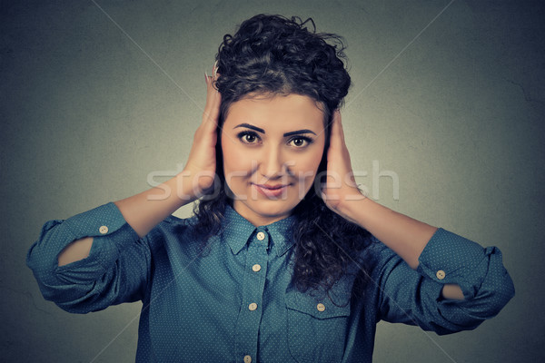 happy attractive casual woman covering with hands her ears eyes opened Stock photo © ichiosea