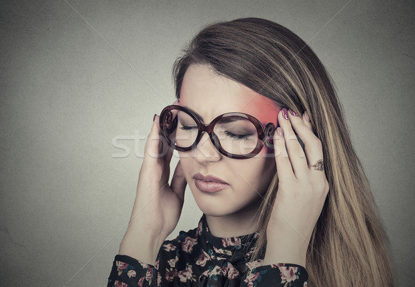sad woman in glasses with stressed face expression headache pain touching temples Stock photo © ichiosea