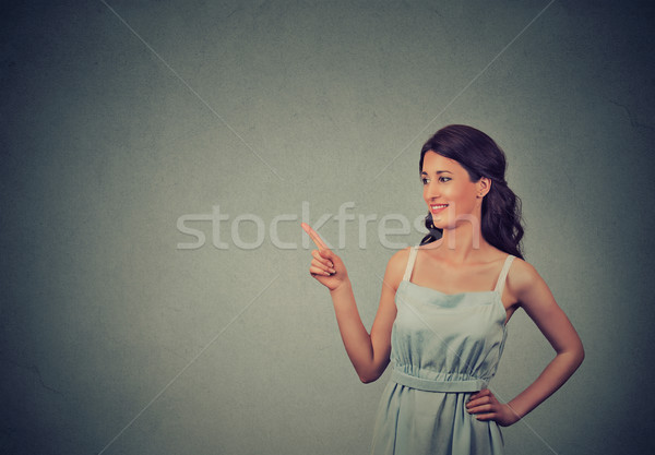 young woman showing pointing with finger at copy space for product or text Stock photo © ichiosea