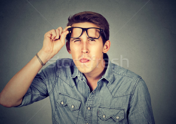 Funny looking skeptical man in glasses   Stock photo © ichiosea
