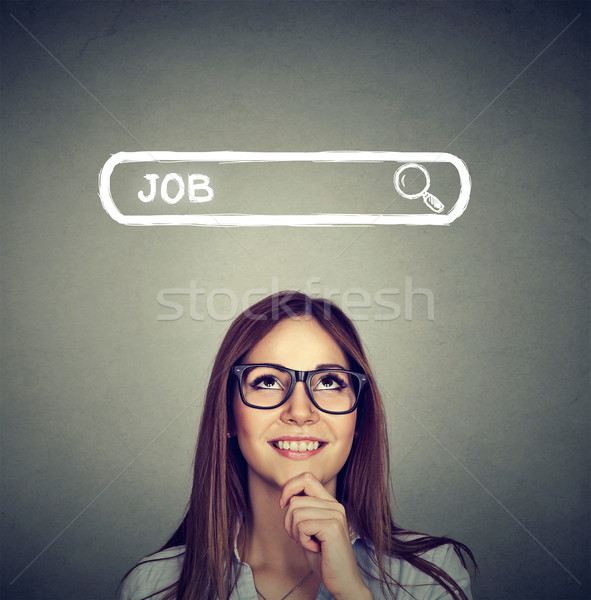 Woman in glasses thinking looking for a new job  Stock photo © ichiosea