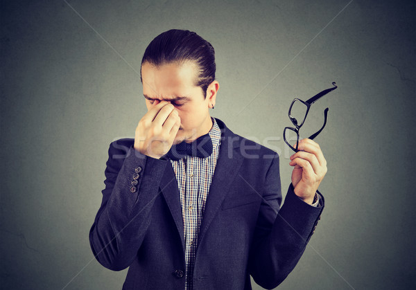 Stressful man rubbing nose Stock photo © ichiosea