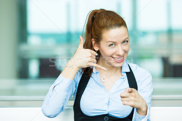 Woman giving call me sign Stock photo © ichiosea