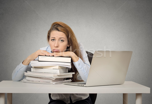 Demotivated bored female student sitting in at desk Stock photo © ichiosea