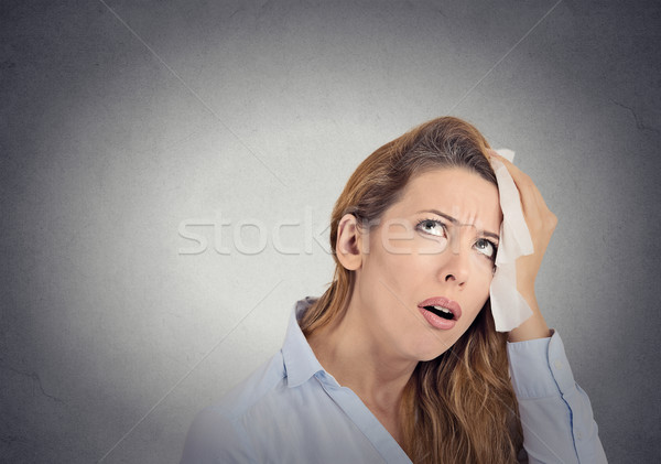 tired worried woman wipes sweat on her face Stock photo © ichiosea