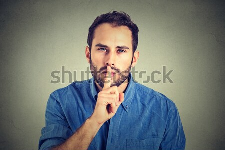 disgusted man with finger in mouth displeased with situation ready to throw up Stock photo © ichiosea