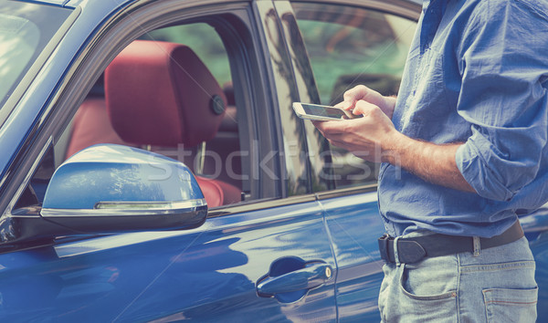 Mobile phone apps for car owners. Man using smartphone to check status control  car Stock photo © ichiosea