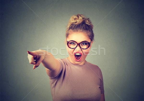Zangado mulher alguém gritando indicação dedo Foto stock © ichiosea