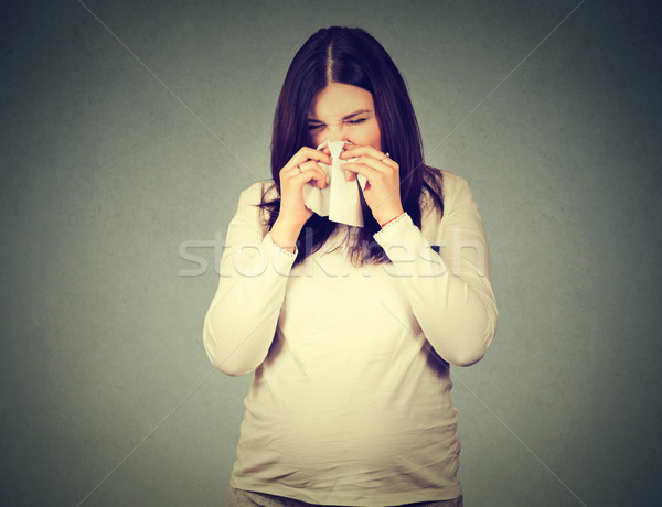 pregnant woman sneezing having cold blowing runny nose Stock photo © ichiosea