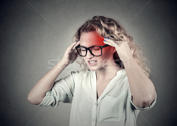 woman with headache, migraine, stress, with red alert accent Stock photo © ichiosea
