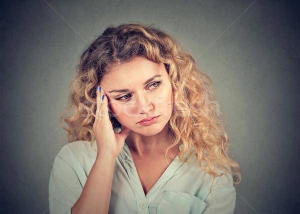 Retrato triste mujer mirando hacia abajo pared jóvenes Foto stock © ichiosea