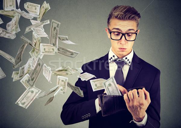 деловой человек глядя бумажник деньги доллара Сток-фото © ichiosea