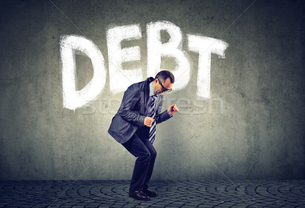 Stressed business man under debt pressure financial burden   Stock photo © ichiosea