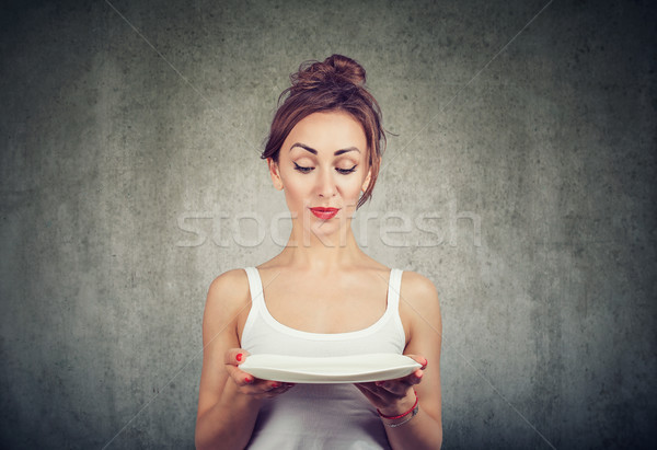 Woman with empty plate being on diet Stock photo © ichiosea