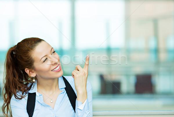 деловой женщины указывая портрет очаровательный улыбаясь Сток-фото © ichiosea
