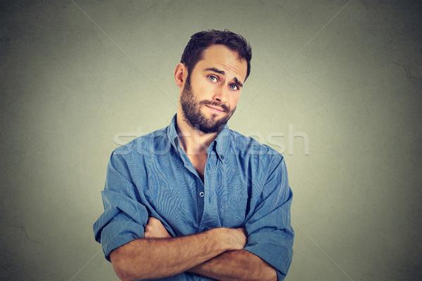 Szkeptikus férfi néz gyanús undor arc Stock fotó © ichiosea