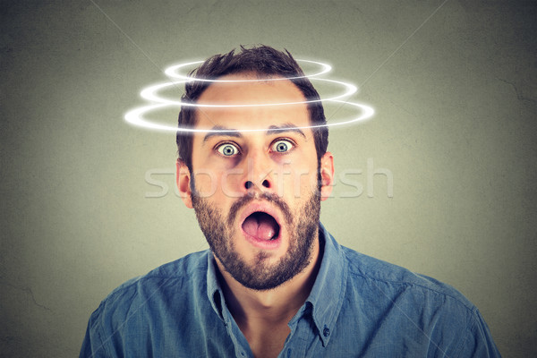 Head is spinning. Surprise astonished man. Stock photo © ichiosea