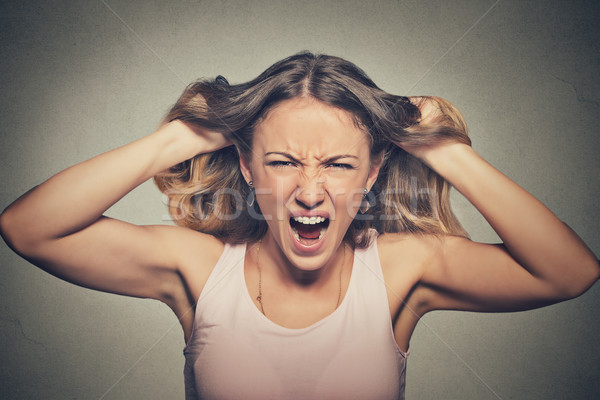 frustrated angry woman pulling hair out yelling screaming Stock photo © ichiosea