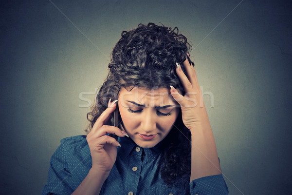 unhappy young woman talking on mobile phone looking down Stock photo © ichiosea
