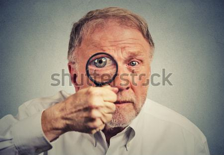 scared middle aged guy biting his nails looking anxious in panic  Stock photo © ichiosea