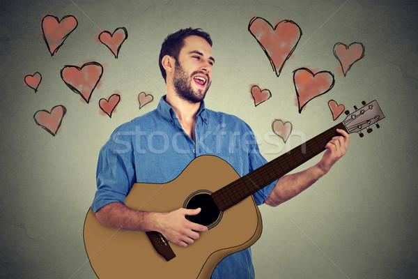 Portré jóképű zenész fiatalember szeretet játszik Stock fotó © ichiosea
