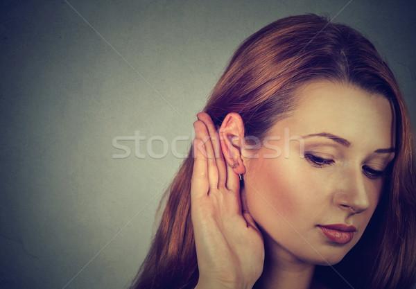 Vrouw hand oor voorzichtig geïsoleerd grijs Stockfoto © ichiosea