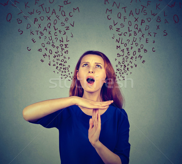 Woman showing time out gesture screaming to stop alphabet letters coming out of mouth Stock photo © ichiosea