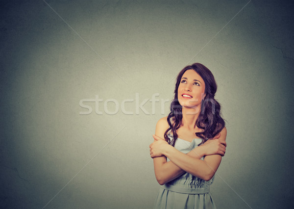 confident smiling woman holding hugging herself dreaming contemplating Stock photo © ichiosea