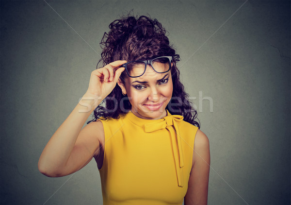Doubtful skeptical woman thinking looking at you with disapproval Stock photo © ichiosea