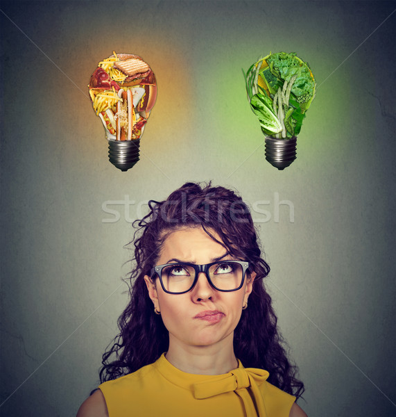 Woman thinking looking up at junk food and green vegetables light bulb  Stock photo © ichiosea