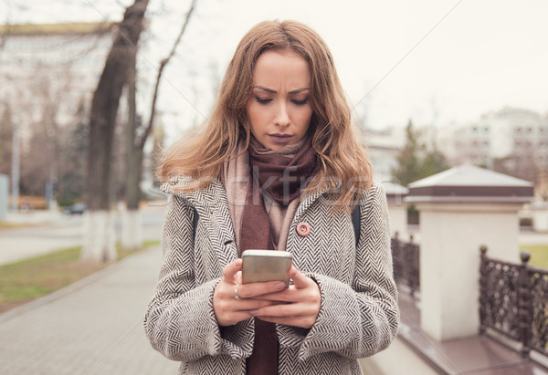Sad girl using phone on street Stock photo © ichiosea