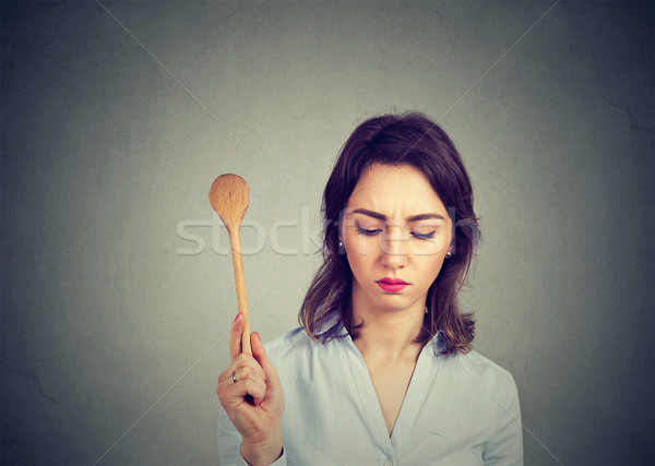 Sad housewife woman looking down Stock photo © ichiosea