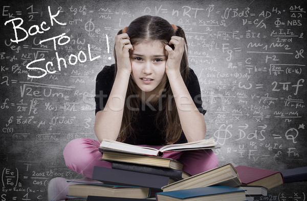 Stressed, tired, overwhelmed little girl, student, pupil Stock photo © ichiosea