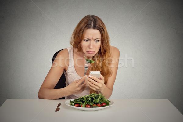 Kız yeme yeşil salata bakıyor Stok fotoğraf © ichiosea