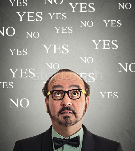 Határozatlan üzletember portré felfelé néz szürke fal Stock fotó © ichiosea