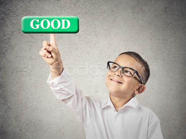 Boy clicks on Good Button Stock photo © ichiosea