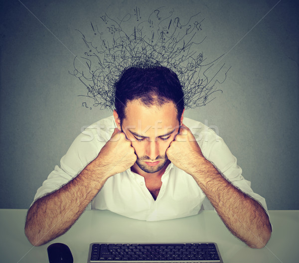 Sad man with brain melting into lines looking at computer keyboard Stock photo © ichiosea