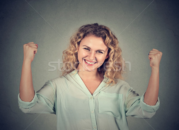 happy successful woman pumping fists celebrating success Stock photo © ichiosea