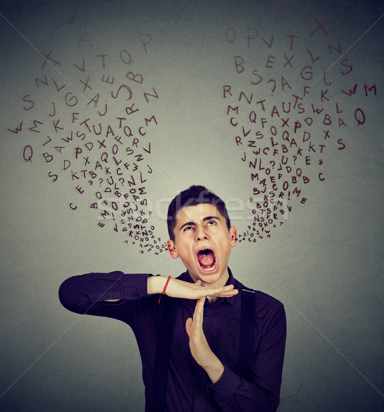 Man showing time out gesture screaming alphabet letters coming out of mouth Stock photo © ichiosea