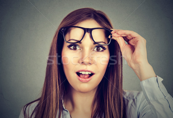 Surprised girl taking off her glasses  Stock photo © ichiosea