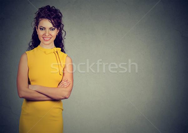 Portre genç gülümseyen kadın sarı elbise yalıtılmış Stok fotoğraf © ichiosea