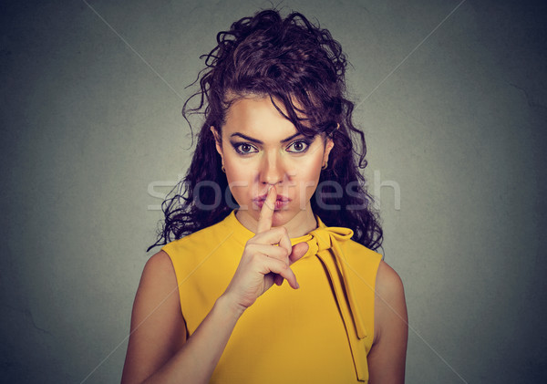 Secretive woman with finger on lips asking shh, quiet  Stock photo © ichiosea