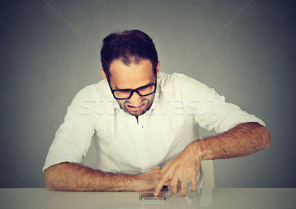 Disgusted man reading a text message scrolling down an email  Stock photo © ichiosea