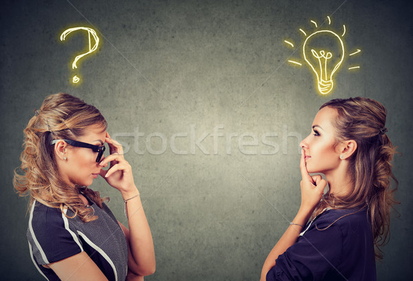 Two women thinking one has a question another solution with light bulb above head Stock photo © ichiosea