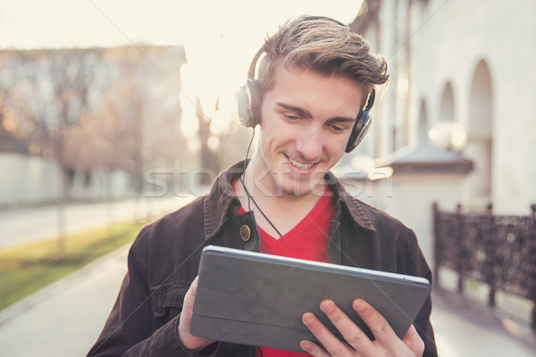 Handsome man using tablet outside Stock photo © ichiosea