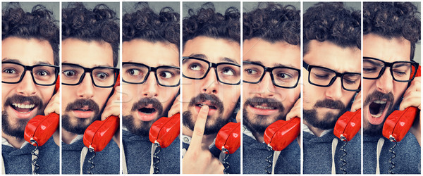 man changing emotions from happy to angry while answering the phone Stock photo © ichiosea